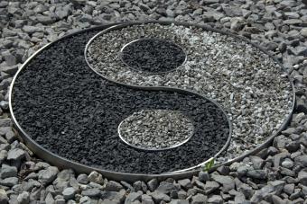 Yin yang sign in garden rocks