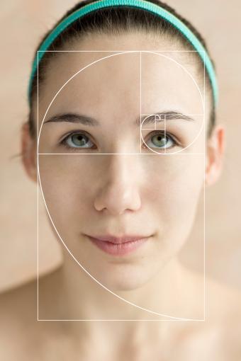 Golden spiral overlay on female face