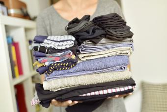 Woman with a pile of folded clothes