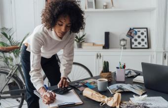Freelancer standing at her desk