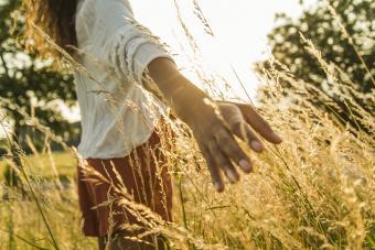 Woman touching long grass