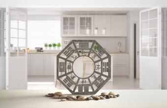 White table shelf with bagua and pebble stone