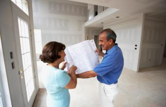 Senior couple looking at blueprints in new house