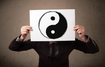 Businessman holding a paper with yin-yang