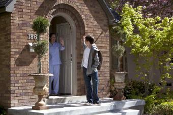 Waving goodbye at the front door