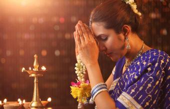 Woman praying in pooja room