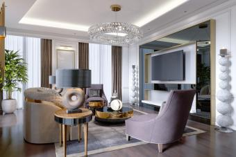 Luxurious living room in modern style with sofa, armchair and crystal chandelier