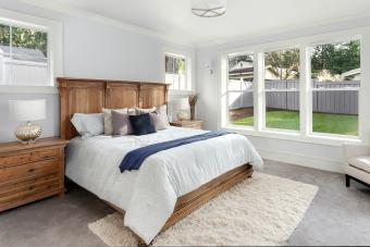 Bed between two windows