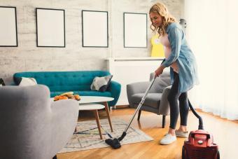 Pregnant Woman Vacuuming carpet