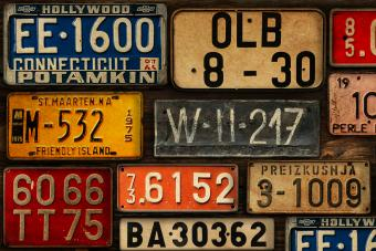 Licence Plates on Wooden Wall