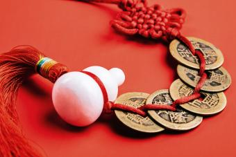Chinese red knot, jade gourd and bronze coins