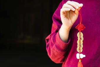 Chinese new year celebration-woman holding a Fengshui ornament