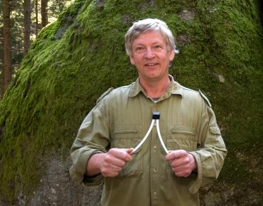 Man using dowsing rods