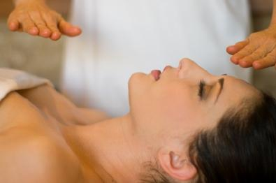 Photo of a Reiki practitioner healing a woman