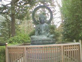 Place your iron Buddha in the garden.