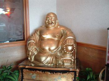 Laughing Buddha statue in the home