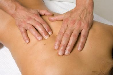 Practitioner applying polarity therapy to a client's back