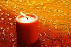 Feng Shui red candle to encourages wealth