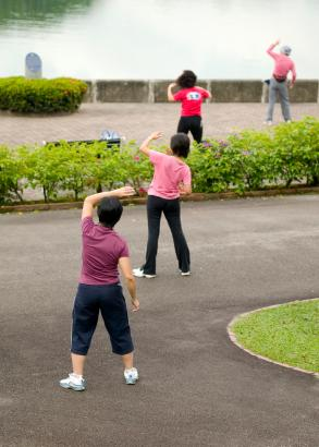 people practicing qigong techniques