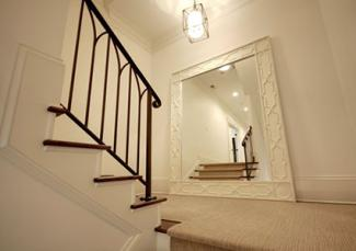 Traditional stair case with mirror