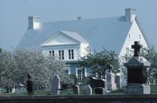 Cemetery in front of house