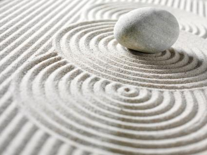 Zen Pebble and Circles in sand