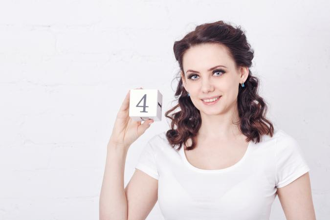 Girl holding number