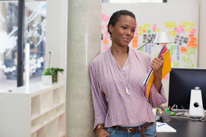 Businesswoman holding paperwork