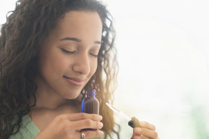smelling aromatherapy oil
