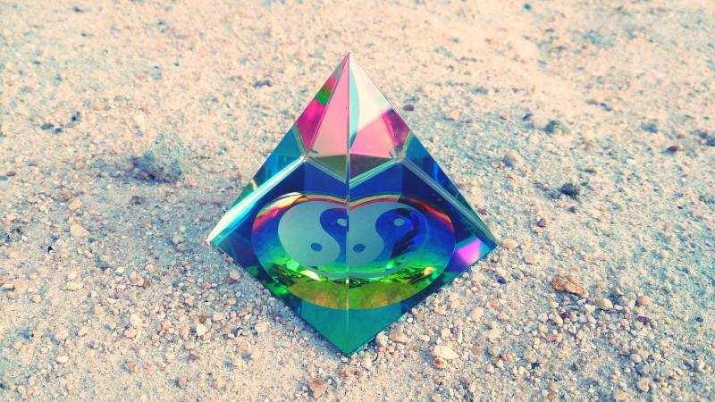 Yin Yang Symbol In Crystal Pyramid