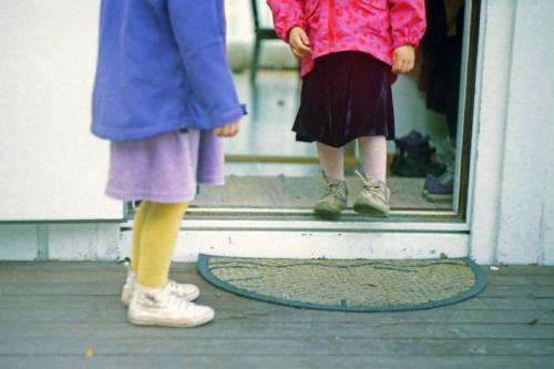 kids with semi-circular door mat