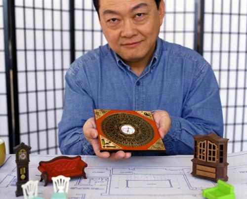Feng Shui consultant holding loupan