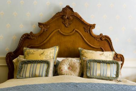 Elegant wooden headboard against wall