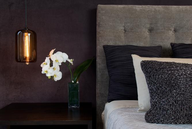 Monochrome bedroom with white orchid