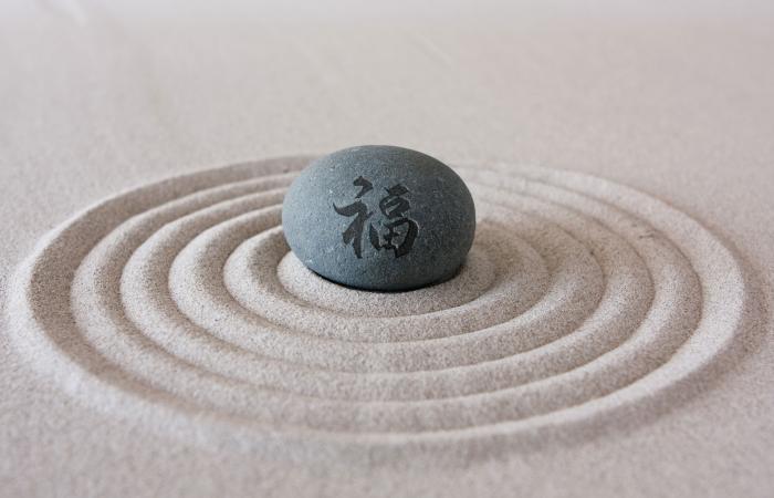 Zen garden good fortune rock