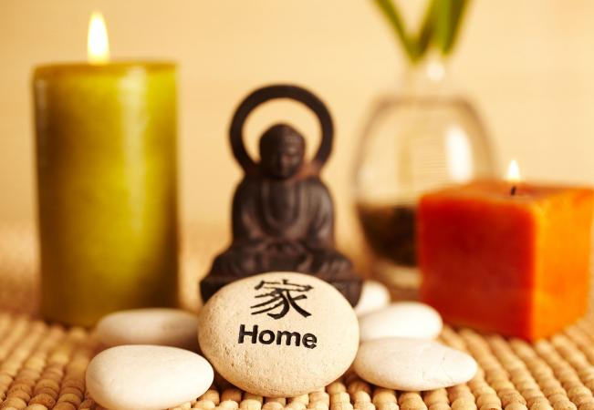 Buddha statue candles and home pebble