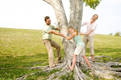 Creative family pose around tree