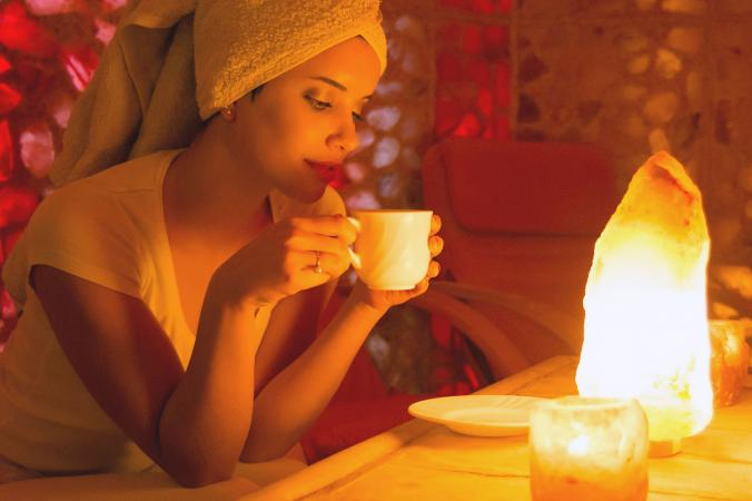 Woman in front of salt lamp