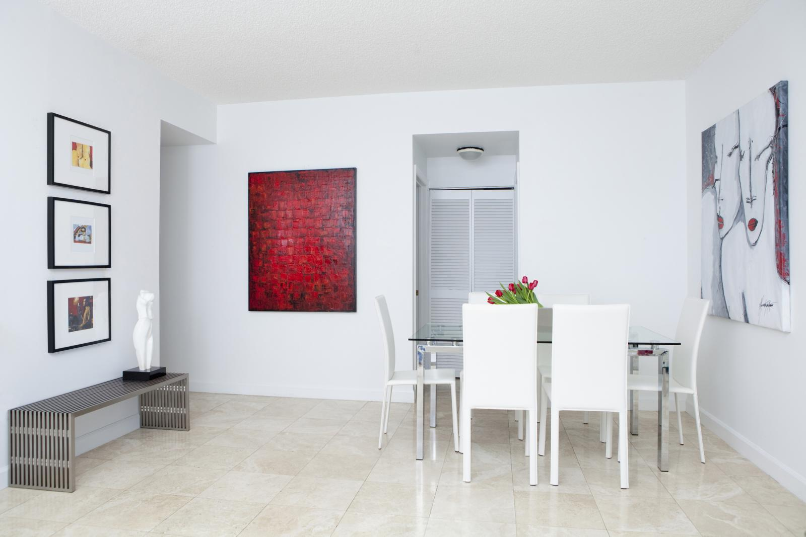 Wall art, table and chairs in modern dining room