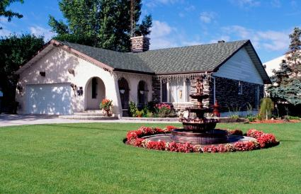 House With Landscaped Front Yard And Water Fountains