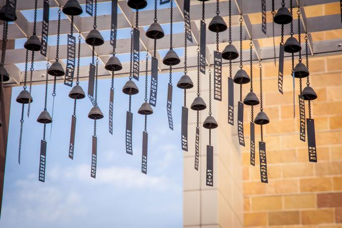 Metal wind chimes outside building