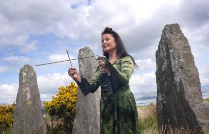 Woman using dowsing rod