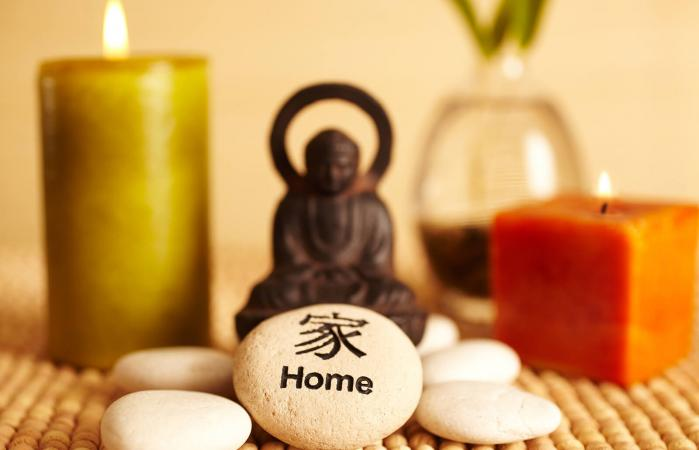 Buddha statue and candles, home pebble