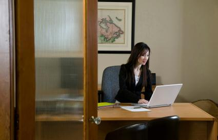 Businesswoman using a laptop in an office