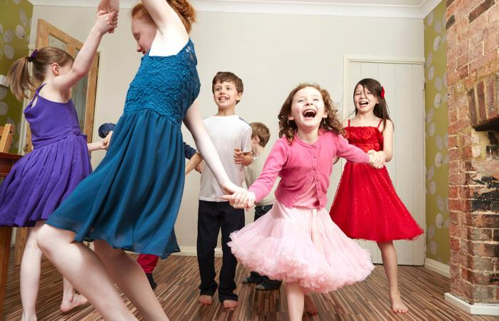 Children dancing at home