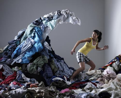 Woman chased by laundry pile