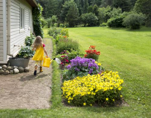 Girl in tidy side yard