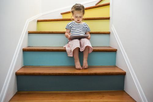 Girl on colorful staircase