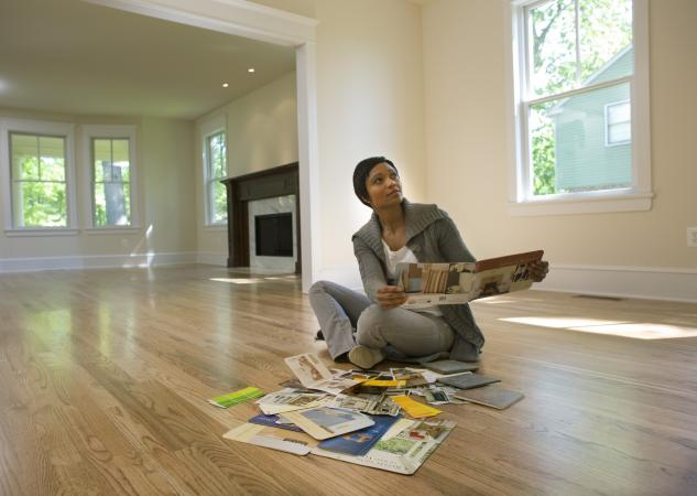Woman in empty house planning decor