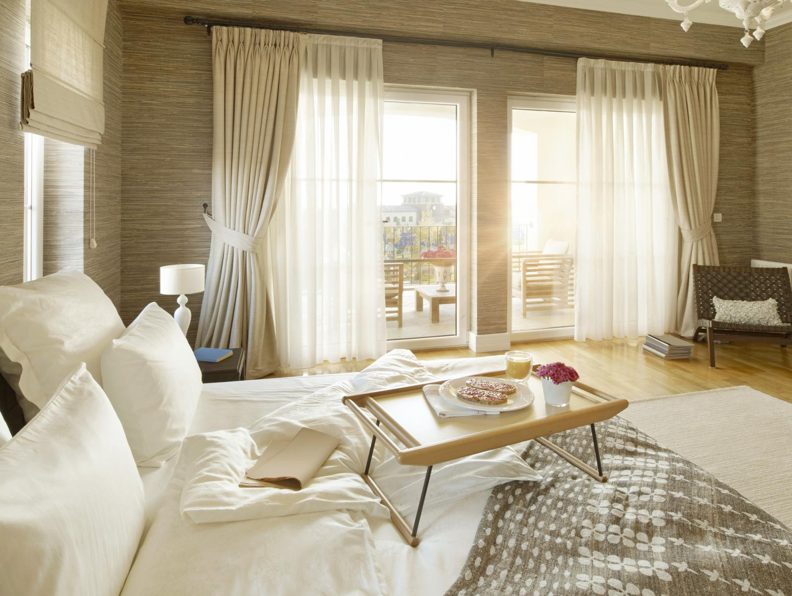 Comfortable bedroom with big windows